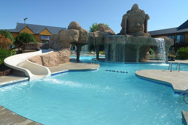 View of the Polynesian Water Park Resort Outdoor Pool with Waterfall and Water Slide 600